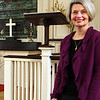 Rev. Deirdre White of Annisquam Village Church stands in the sanctuary where she infuses performing arts into her ministry and worship. Jesse Poole/Gloucester Daily Times Feb. 07, 2012