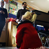 Jesse Poole/Staff photo. Gloucester Daily Times. Gloucester: McKenna Ciolino, 2, of Gloucester, sits on the floor of a classroom at Eastern Point Day School as she watches students make toys and crafts that suit her and children similar to her: those diagnosed with Emanuel syndrome. Her mother, Chelsie Larry, brought her to the Gloucester school on Tuesday morning so that students could learn about the syndrome and meet McKenna. Jesse Poole/Gloucester Daily Times
