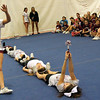 "ALLEGRA BOVERMAN/Staff photo. Gloucester Daily Times. Gloucester: Almost 60 girls participated in the Gloucester Cheer Mini Camp this past week and they held a show for parents and friends on Thursday at the Gloucester High School field house. Cheerleaders did little skits during the performance including this one about the Greasy Pole. Doing handsprings along the ""greasy pole"" is junior Erin Jermyn. The ""pole"" was comprised of, front to back: junior Kayla Harris, and sophomores Maddie Puccio,  Samantha Ryder and Lexi Testaverde."