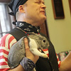 Allegra Boverman/Gloucester Daily Times. Magician Robb Preskins holds his rabbit, Thunder, after making it appear in a magic trick during his magic show at Manchester Public Library on Tuesday.