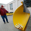 Allegra Boverman/Gloucester Daily Times. Peter Dennen, supervisor of highway and public properties for Gloucester, talks about how the Department of Public Works is preparing for the storm this weekend. Plows will be attached to trucks on Saturday.
