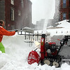 Allegra Boverman/Gloucester Daily Times. Prospect Street was partially closed for more plowing and clearing of snow in the sidewalks on Monday. Here workers were clearing sidewalks along Prospect Street and inside St. Ann School.