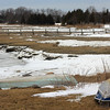 Allegra Boverman/Gloucester Daily Times. Dreaming of boating weather. The Essex River was partially frozen over as seen from Water Street on Tuesday afternoon.