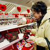 Allegra Boverman/Gloucester Daily Times. Carol Linsky of Gloucester, executive director of the Rockport Art Association, selects chocolates for her colleagues at Tuck's Candies in Rockport on Wednesday.