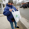 Allegra Boverman/Gloucester Daily Times. Anna Kasabian of Manchester on Tuesday as she left's Allen's Pharmacy. There is a proprosal to ban the distribution and use of plastic bags with handles for the Town Meeting warrant.