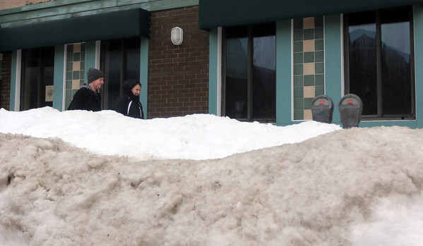 Allegra Boverman/Gloucester Daily Times. Snow is piled high downtown in Gloucester.