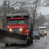 Allegra Boverman/Gloucester Daily Times. Plow trucks carrying sand were starting to make their way around Gloucester on Friday as the storm began. A few were along Washington Street here.