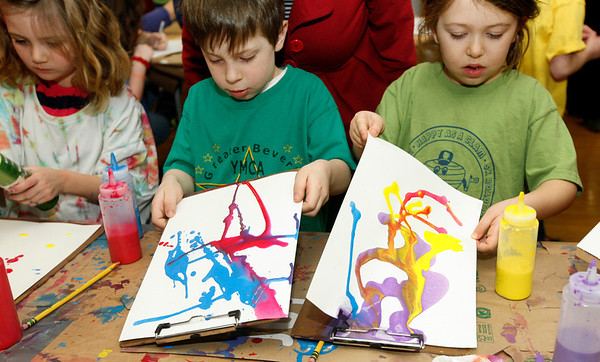 Allegra Boverman/Gloucester Daily Times. From left are Essex Elementary School kindergarteners Avery Dott, Thomas Williams and Becca Briggs. They were busy creating art using just paint, water and gravity at a table presented by artist Kathleen McHugh of Essex during the fourth annual Messy Art Night at the school on Friday evening. The home and museum has over 148 boxes on site and there is a special tour just of the boxes when the museum is open. The Essex Elementary School PTO sponsored Messy Art Night, which featured over a dozen local artists plus the staffs of Art Haven, Cogswell Grant and the Essex Shipbuilding Museum.