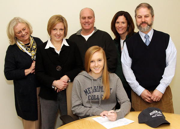 Allegra Boverman/Gloucester Daily Times. Nicole Bradley, seated center, a senior field hockey player at Manchester Essex Regional High School, signed a letter of intent to attend Merrimack College to play field hockey. Around her from left are: Interim Principal Sharon Maguire, Bradley's mother and father Karen and Rob, Athletic Director  Kelly Porcaro and Assistant Principal Paul Murphy.