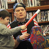Allegra Boverman/Gloucester Daily Times. Magician Robb Preskins, right, reacts to the magic Ian Campbell, 5, left, is helping him make during teh Magic Pirate Show held at the Manchester Public Library on Tuesday afternoon.