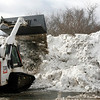 Allegra Boverman/Gloucester Daily Times. The city is disposing of the snow it plows in the main parking lot at Stage Fort Park.