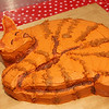 Allegra Boverman/Gloucester Daily Times. Stubby the cat was the guest of honor at a Valentine's Day/birthday party held Thursday at Maritime Gloucester. Veterinarian Donna Heaney baked this Stubby-shaped cake for the event. She is the wife of Maritime Gloucester executive director Tom Balf; both were at the party.