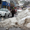 Allegra Boverman/Gloucester Daily Times. Snow piled in the streets on Monday in Gloucester was making passing through some streets and sidewalks more difficult - one example here along Main Street at the intersection of Manuel F. Lewis Street.