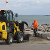 Jim Vaiknoras/Gloucester Daily Times: Rockport DPW workers repair dmage from last week's Blizzard to Bear Skin Neck in Rockport.