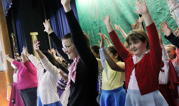 """Allegra Boverman/Gloucester Daily Times. East Gloucester Elementary School fifth grade teacher Diana Shanks, left, and fifth grader Lara Brighi, right, were rehearsing """"Doo-Wop Wed Widing Hood,"""" a comic musical the entire fifth grade and their teachers are to perform Thursday and Friday at 7 p.m. and Saturday at 3 p.m. at the Davis Street Extension school. Tickets are $5 per person."""