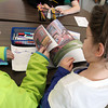 """Allegra Boverman/Gloucester Daily Times. The """"One School, One Book"""" program program at Manchester Memorial Elementary School kicked off this week. On Thursday, fifth graders and their kindergarten buddies read the book together. From left are fifth grader Annika Smith and her buddy Parker Leavitt."""