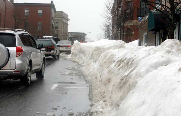 Allegra Boverman/Gloucester Daily Times. Snow piled in the streets on Monday in Gloucester was making passing through some streets and sidewalks more difficult - one example was along Main Street just before the intersection of Pleasant Street, Main Street and Duncan Street.