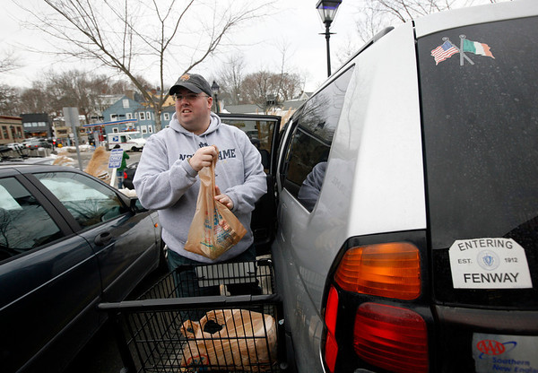 Allegra Boverman/Gloucester Daily Times. Tim Migneault of Manchester was shopping for groceries at Crosby's Marketplace on Tuesday. He was using plastic bags for his groceries. There is a proprosal to ban the distribution and use of plastic bags with handles for the Town Meeting warrant.
