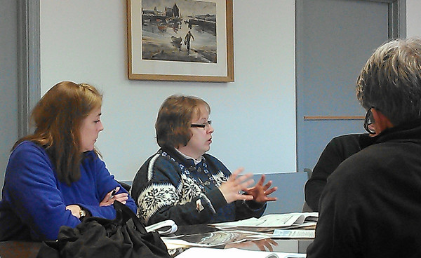 James Niedzinski/Gloucester Daily Times. Kathryn Glenn, left and Rebecca Hanley talk with the state's Coastal Zone Management address Rockport Department of Public Works Commissioners and staff at town hall.