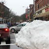 Allegra Boverman/Gloucester Daily Times. Streets in Gloucester have so much snow piled up that it's difficult to see cars and pedestrians at corners like Hancock and Main Streets.