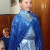 """Allegra Boverman/Gloucester Daily Times. East Gloucester Elementary School fifth grader Logan Adams, front, playing The King, strides onstage with, behind him, Ivo Allen, playing The Lord, in """"Doo-Wop Wed Widing Hood,"""" a comic musical the entire fifth grade and their teachers are to perform Thursday and Friday at 7 p.m. and Saturday at 3 p.m. at the Davis Street Extension school. Tickets are $5 per person."""