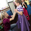 """Allegra Boverman/Gloucester Daily Times. Kelley Montagnino, left, helps East Gloucester Elementary School fifth grader Kylie Jackson with her costume on Tuesday. Behind her waiting for help are Amy Petralia and Pharah Donlan. They are performing in """"Doo-Wop Wed Widing Hood,"""" a comic musical the entire fifth grade and their teachers are to perform Thursday and Friday at 7 p.m. and Saturday at 3 p.m. at the Davis Street Extension school. Tickets are $5 per person."""