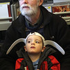 Allegra Boverman/Gloucester Daily Times. Bill Collins and his grandson Soren Collins, 3, were enjoying the Magic Pirate Show at Manchester Public Library on Tuesday. Soren was wearing rabbit ears for the event.