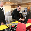 ALLEGRA BOVERMAN/Gloucester Daily Times. During Gloucester's Second Annual Maritime Summit held at Cruiseport Gloucester on Thursday, Dirk Casagrande, left, vice president of Sea Sciences, Inc., based out of Arlington, discusses what they do with graduate student Will Sinatra.
