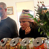 Allegra Boverman/Gloucester Daily Times. Frank Diodati, left, and Laura Ritchie, both of Gloucester, watch admiringly as turtles and other freshly made chocolates are placed on cooling racks at Turtle Alley Chocolates on Wednesday