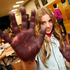 Allegra Boverman/Gloucester Daily Times. Kara Glynos, an Essex Elementary School fifth grader, shows off her dirty hands created during the fourth annual Messy Art Night at the school on Friday evening. The Essex Elementary School PTO sponsored the event, which featured over a dozen local artists plus the staffs of Art Haven, Cogswell Grant and the Essex Shipbuilding Museum.