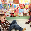 Allegra Boverman/Gloucester Daily Times. Robbie Young, 4, sits near his tile he painted for the Pathways for Children mosaic recently installed at the Gloucester center. In 2012, all the children painted tiles that were installed in a path-shaped mosaic with the help of Rockport artist Eileen Mueller.
