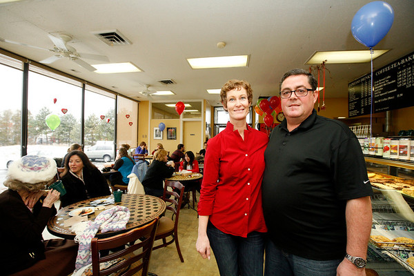 Allegra Boverman/Gloucester Daily Times. Dorthe and Rick Noonan, owners of Cape Ann Coffees, were celebrating 10 years being in business and at their location on Bass Avenue on Tuesday. They were offering 10 cent beverages all day.