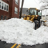 Allegra Boverman/Gloucester Daily Times. Prospect Street was partially closed for more plowing and clearing of snow in the sidewalks on Monday. Here, snow was being removed from Prospect Street near Maplewood Avenue at St. Ann School.