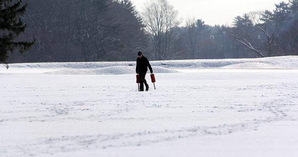 Allegra Boverman/Gloucester Daily Times. Chris Wells, assistant golf pro at Essex County Club, picks up balls from the driving range on Wednesday morning. The golf course allows people to use the course all year long, including in winter. He usually comes through every couple weeks to retrieve the balls.