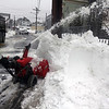 Allegra Boverman/Gloucester Daily Times. Prospect Street from Washington St. to Maplewood Avenue was closed for more plowing and clearing of snow in the sidewalks on Monday. Crews were clearing snow from St. Ann School, too.