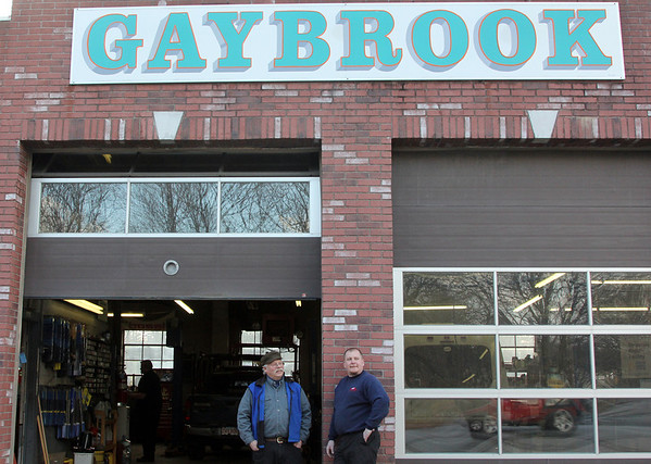 Allegra Boverman/Gloucester Daily Times. Gaybrook Garage in Essex is changing hands. Stan Collinson, left, and his wife Daisy Nell have sold the historic garage to their employee Mike Crowley,right.