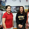 Allegra Boverman/Gloucester Daily Times. Bianca Giacalone, second from right, a Gloucester High School senior, signed a letter of intent to attend Merrimack College to play soccer and run track and field on Wednesday. She is with her  coaches, from left: Jeff Destino, track and field, Alex White, soccer, and Liz Moran, track and field.