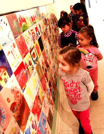 Allegra Boverman/Gloucester Daily Times.  Children in the Pathways for Children program look for thier tiles on the new mosaic wall installed recently at the center. All children at the center decorated a tile in 2012 for this wall. From front to back are: Anaya Briguglio, Kiara Curcuru, Natasha DePaula and Yoemily Castillo.