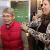 """Allegra Boverman/Gloucester Daily Times. Stubby the cat was the guest of honor at a Valentine's Day/birthday party held Thursday at Maritime Gloucester. """"Pin the tail on the Stubby"""" was a popular game during the party. Colette Cipullo, right, spins Ann Banks around before she tried her luck with the game during the party."""