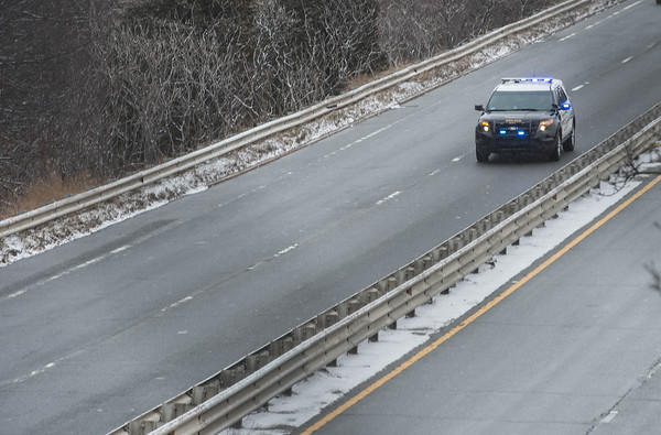 Desi Smith/Staff photo.     Police respond to a three car accident on 128 just after exit 15 in Manchester Friday morning. Multiple accidents were reported on the roads and highways due to black ice and snow during the morning commute.   March 4,2015