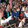 Gloucester: Seize the Moment's Joe Sanfillippo raises the flag after beating Kaos in a close race during the Senior Seine Boat Race,Sunday afternoon on Pavilion Beach. Desi Smith Photo/Gloucester Daily Times. June 28,2009