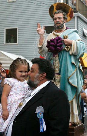 Gloucester: Allie Rose Nicastro kisses her uncle, Dominic Nicastro, outside St. Peter's Club before the procession of St. Peter last night. Photo by Kate Glass/Gloucester Daily Times Friday, June 26, 2009
