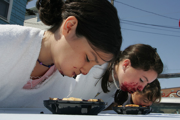 Gloucester: Isabella Prendergast takes a mouth full of pie while competing against Lacey Thompson and Rachel Parisi during a pie eating contest at Beach Court Saturday afternoon.  Rachel Parisi beat out the other two girls. Mary Muckenhoupt/Gloucester Daily Times