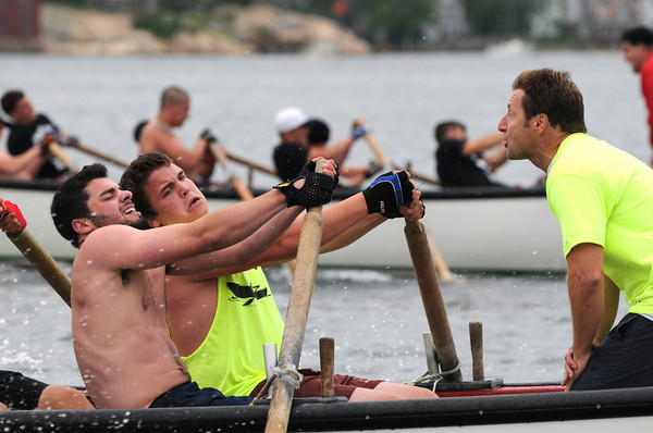 Gloucester: Relentless coxswain Jeff Muise yells encouragement to crew members Marc Alves (left) and Tom Molloy as they go on to win the Jr  Seine Boat Race,Sunday afternoon on Pavilion Beach. Desi Smith Photo/Gloucester Daily Times. June 28,2009