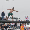 Gloucester: A walker makes like this seagull as he makes his way across the pole in Saturdays Greasy Pole contest.Desi Smith Photo/Gloucester Daily Times. June 27,2009.