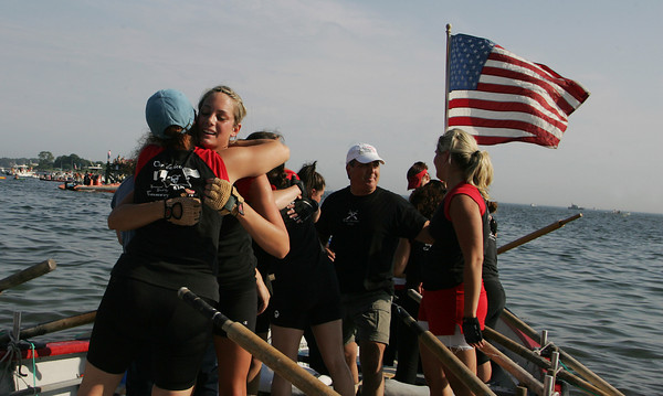Gloucester: Asley Amero hugs teammate Bobbie Balzano-Owens, left, after Oar'Dacious wins the woman's seine boat championship Friday night. Mary Muckenhoupt/Gloucester Daily Times