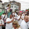 Gloucester: The procession stops in front of the house of Nina Kendall on Prospect Street during the Fiesta procession Sunday. The procession stopped here to honor a number of women who were significant figures in the early Fiesta celebrations. Photo by Mary Muckenhoupt/Gloucester Daily Times