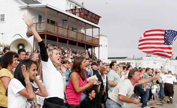 Gloucester: Fans cheer from Pavilion Beach as Kaos pulls ahead of Seize the Moment in the senior seine boat race yesterday afternoon. Photo by Kate Glass/Gloucester Daily Times Sunday, June 28, 2009