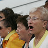 Gloucester: Rose Verga sings a hymn during Fiesta mass at St. Peter's Square Sunday. Mary Muckenhoupt/Gloucester Daily Times