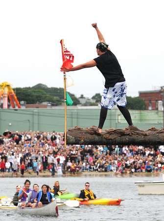 Gloucester: Stew McGillivray raises his fist to the crowd after grabbing the flag in the second round of the greasy pole contest Sunday afternoon. Desi Smith Photo/Gloucester Daily Times. June 28,2009